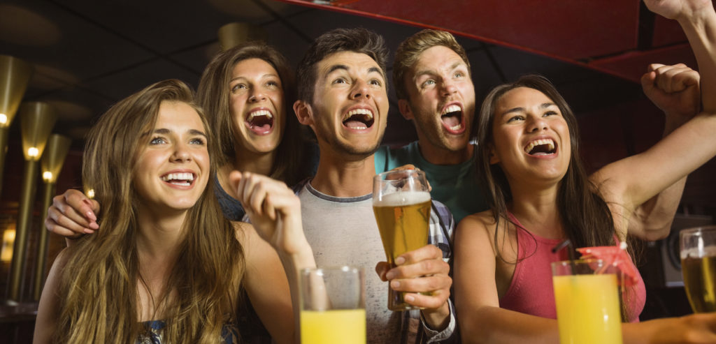 Happy-friends-drinking-beer-and-cheering-together-000056061894_Full